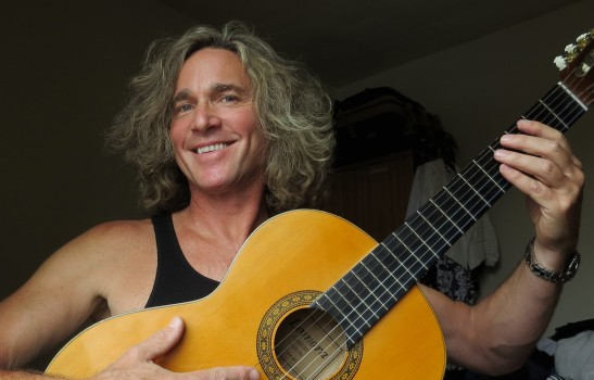 Jeffrey Walsh with his acoustic guitar